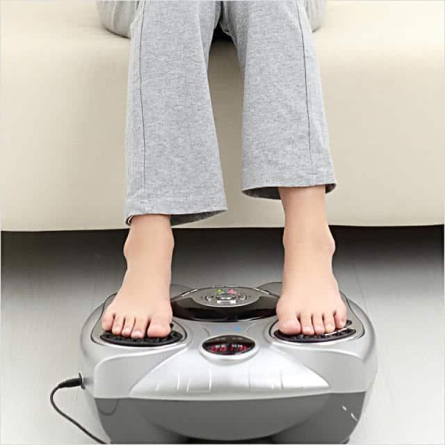 Feet being massaged via foot massager